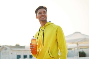 smiling-healthy-athletic-man-with-fit-body-holding-NP7LD2F
